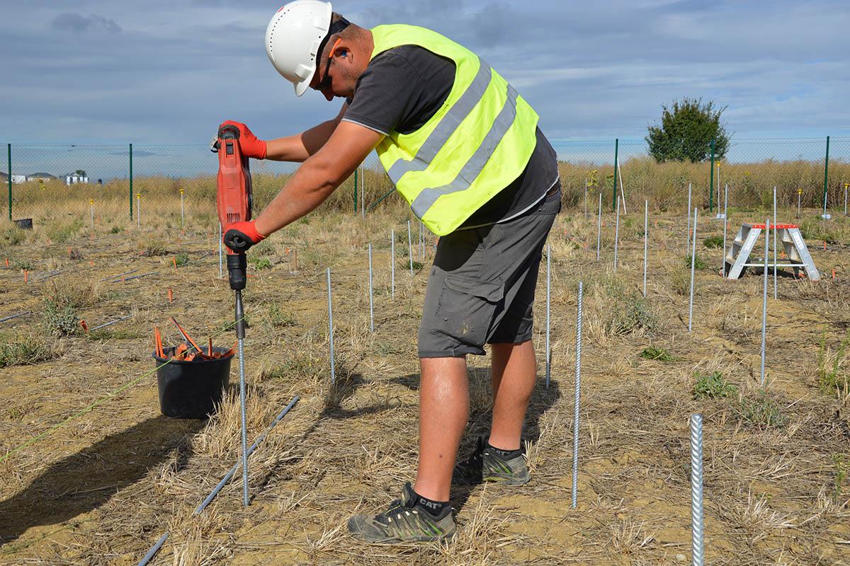Solar power plant installation using hammer drill